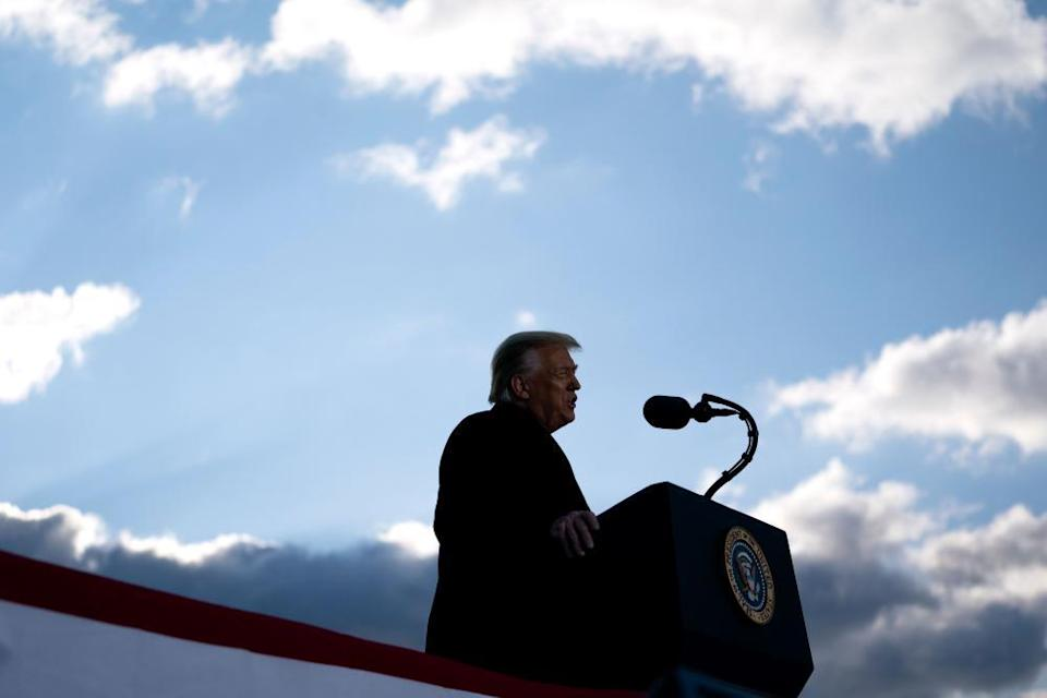 Donald Trump speaks during a farewell ceremony as he departed Washington on 20 January.