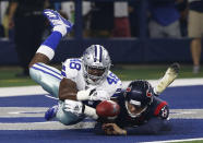 Dallas Cowboys' Joe Thomas (48) recovers a blocked Houston Texans' Trevor Daniel (8) punt-attempt in the end zone for a Cowboys touchdown in the first half of a preseason NFL football game in Arlington, Texas, Saturday, Aug. 24, 2019. (AP Photo/Ron Jenkins)