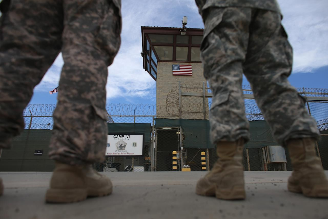 GUANTANAMO BAY, CUBA - JUNE 25: (EDITORS NOTE: Image has been reviewed by the U.S. Military prior to transmission.) Military officers stand at the entrance to Camp VI and V at the U.S. military prison for 'enemy combatants' on June 25, 2013 in Guantanamo Bay, Cuba. President Barack Obama has recently spoken again about closing the prison which has been used to hold prisoners from the invasion of Afghanistan and the war on terror since early 2002. (Photo by Joe Raedle/Getty Images)