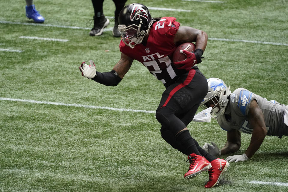 Atlanta Falcons running back Todd Gurley (21) runs for a touchdown against the Detroit Lions during the second half of an NFL football game, Sunday, Oct. 25, 2020, in Atlanta. (AP Photo/John Bazemore)