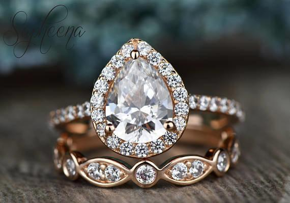 This pear-shaped moissanite engagement ring by seller Sapheena on Etsy also features a moissanite halo.  (Sapheena/Etsy)