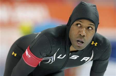 Shani Davis of the U.S. looks at his time after competing in the men's 1,000 meters speed skating race during the 2014 Sochi Winter Olympics