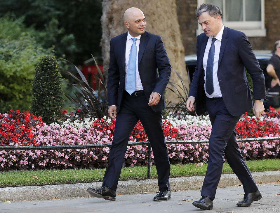 Britain's new Chancellor of the Exchequer Sajid Javid, left, and Northern Ireland Secretary Julian Smith arrive for a Cabinet meeting at 10 Downing Street in London, Thursday, July 25, 2019. Newly appointed Prime Minister Boris Johnson assembles members of his new Cabinet, meeting for the first time Thursday. (AP Photo/Frank Augstein)