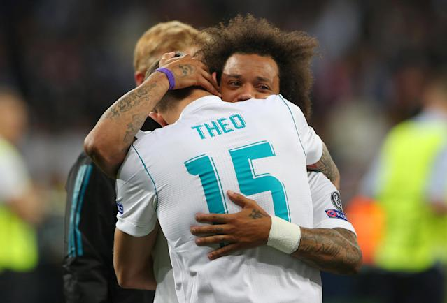 Soccer Football - Champions League Final - Real Madrid v Liverpool - NSC Olympic Stadium, Kiev, Ukraine - May 26, 2018 Real Madrid's Marcelo and Theo Hernandez celebrate winning the Champions League at the end of the match REUTERS/Hannah McKay