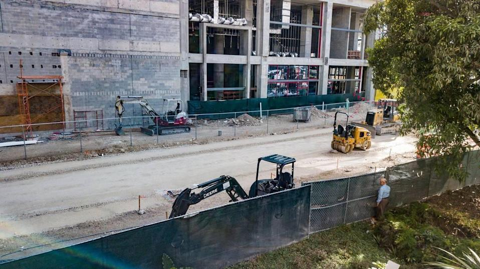 Orlando Capote's front yard now faces the hotel being built as part of the Plaza Coral Gables development.