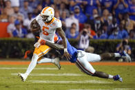 Tennessee quarterback Hendon Hooker (5) can't escape a tackle by Florida linebacker Jeremiah Moon, right, during the second half of an NCAA college football game, Saturday, Sept. 25, 2021, in Gainesville, Fla. (AP Photo/John Raoux)