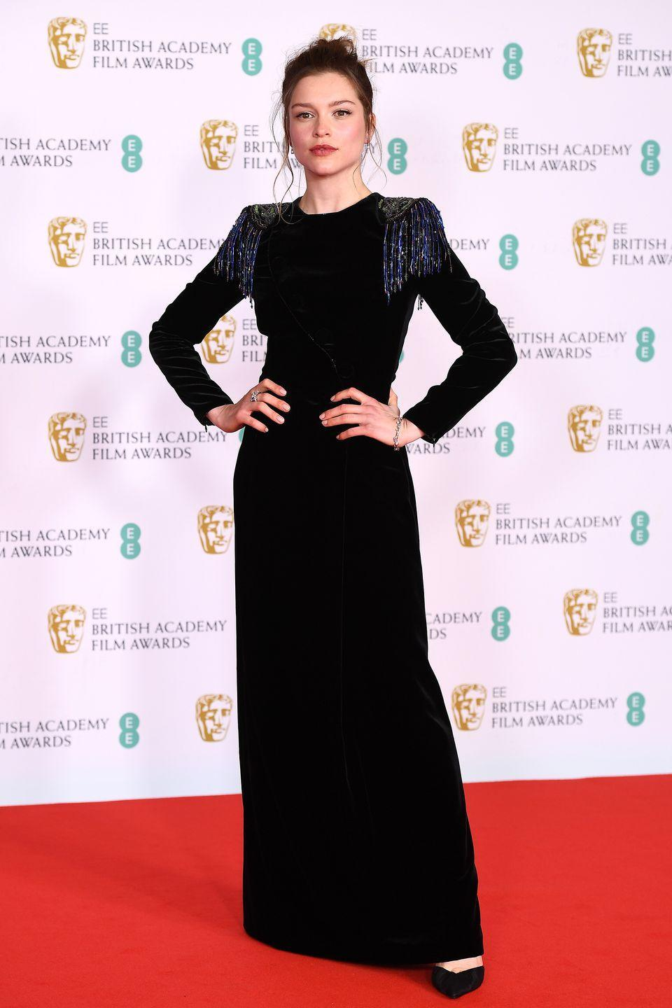 <p>Sophie Cookson looked chic in a Giorgio Armani dress with dramatic shoulder pads. </p>