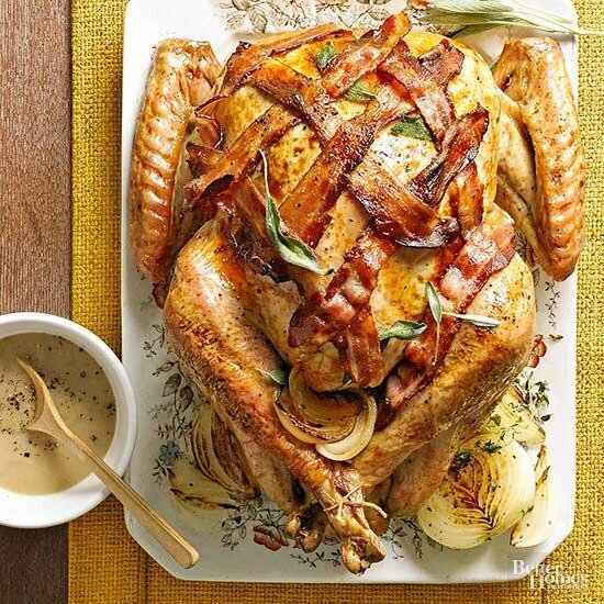 This Bacon Wrapped Turkey recipe is a delicious, crowd-pleasing centerpiece for your Thanksgiving meal. Drizzle each serving with Bacon and Onion Gravy that's accented with a pinch of fresh sage.