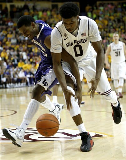 Washington's C.J. Wilcox, left, and Arizona State's Carrick Felix (0) chase a loose ball during the second half of an NCAA college basketball game, Saturday, Feb. 23, 2013, in Tempe, Ariz. (AP Photo/Matt York)