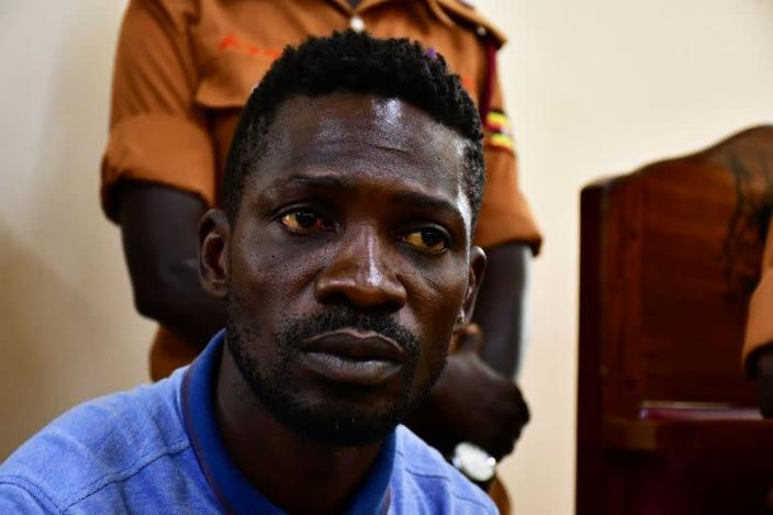 Ugandan presidential candidate Robert Kyagulanyi also known as Bobi Wine sits inside the courtroom in Iganga