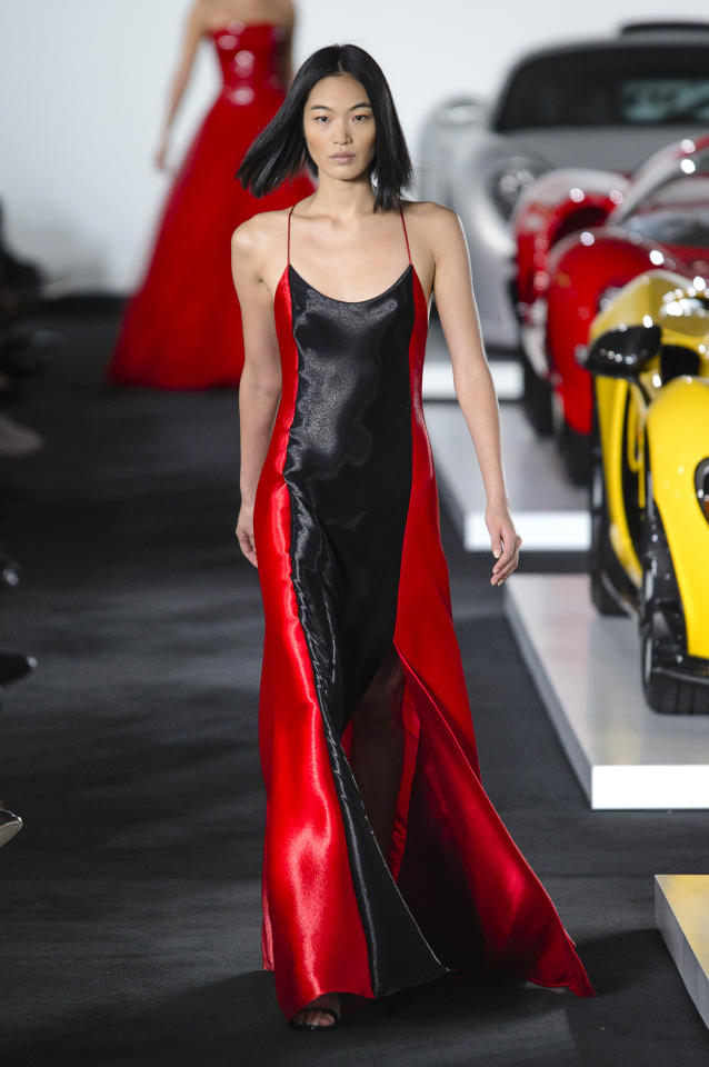 <p>Model wears a black-and-red color-block dress from the SS18 Ralph Lauren collection. (Photo: ImaxTree) </p>