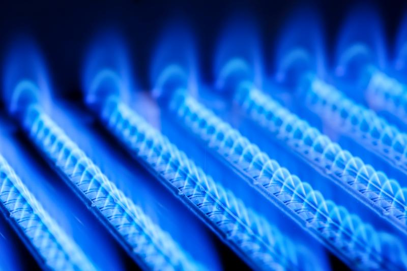 An up-close view of blue flames coming from natural gas-fueled burners.