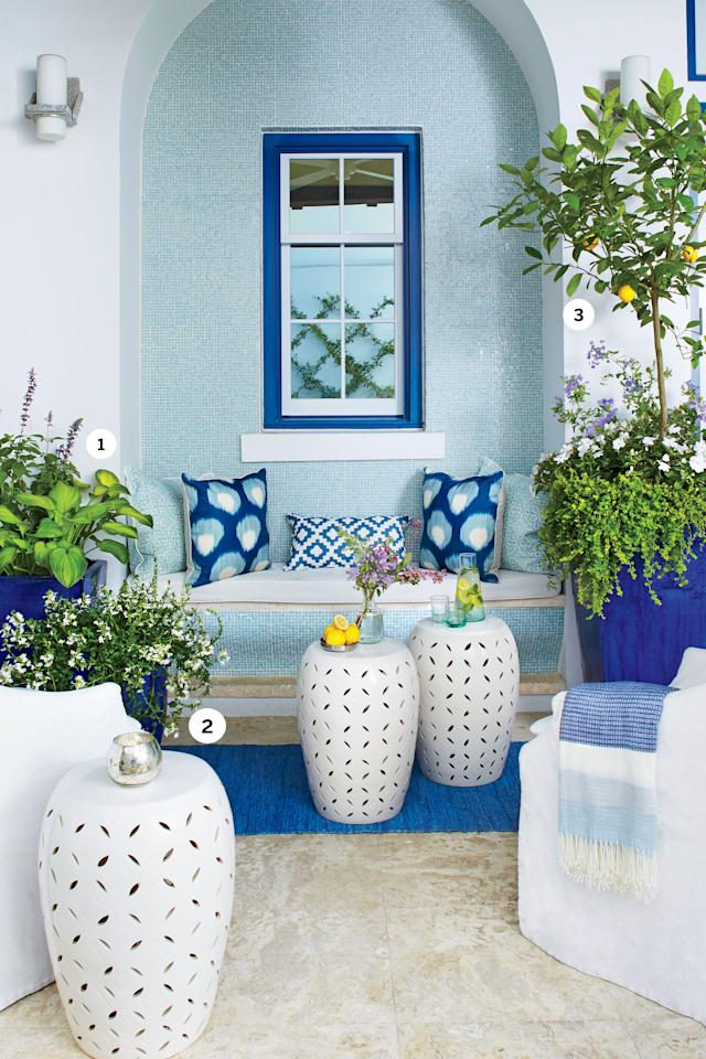 """<p>This covered seating area looks like it could be overlooking a rocky beach in Greece. To maintain that effortlessly European vibe, Daniel chose oversize cobalt-glazed containers that complement the shimmering aqua wall tile and the deep blue accents in the window trim, rug, and pillows. He kept the plant palette calm with pale blues, whites, and greens. Daniel contrasted the dialed-down colors with plantings that spill out of the containers for a lush effect. Planters and stools placed in groups of three soften the strong architecture. To keep the plants thriving, remember not all need lots of water. """"Because this is a shaded, covered porch area with little to no direct sunlight, watering should be light and overwatering must be avoided,"""" Daniel recommends.</p> <p><strong>The Key Plant</strong><br /><a rel=""""nofollow"""" href=""""http://www.southernliving.com/home-garden/gardens/meyer-lemon-tree"""">""""Meyer"""" lemon</a> exudes sunshine with its zesty yellow fruit and has a heavenly scent when in bloom. It's a cross between a lemon and an orange, so you can enjoy its sweet-tart flavor in recipes for everything from vinaigrettes to desserts.</p> <p><strong>What's Growing</strong><br /> [1] Plumbago and """"Guacamole"""" hosta<br /> [2] Fan flower<br /> [3] """"Meyer"""" lemon, plumbago, SunPatiens, and creeping Jenny</p> <p><strong>Pro Tip</strong><br /> Don't choose wimpy plants. Daniel says, """"The Gulf Coast's salt spray, extreme heat, and high humidity mean we're constantly battling insects and disease. We try to pick plants that thrive in the elements."""" That is solid advice no matter where you live in the South.</p>"""