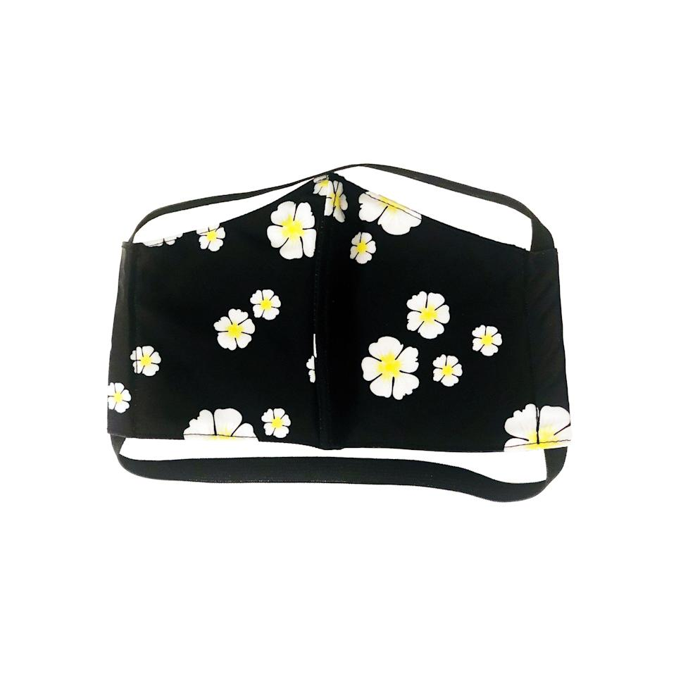 """<p><strong>Tabacaru</strong></p><p>tabacaruswim.com</p><p><strong>$25.00</strong></p><p><a href=""""https://tabacaruswim.com/collections/masks/products/face-mask-black-floral-print-1"""" rel=""""nofollow noopener"""" target=""""_blank"""" data-ylk=""""slk:Shop Now"""" class=""""link rapid-noclick-resp"""">Shop Now</a></p><p>The swim label's upcycled, sustainable masks come in a fun '90's throwback print, and the brand is donating 20% of its mask sales to The Los Angeles Food Bank. </p>"""