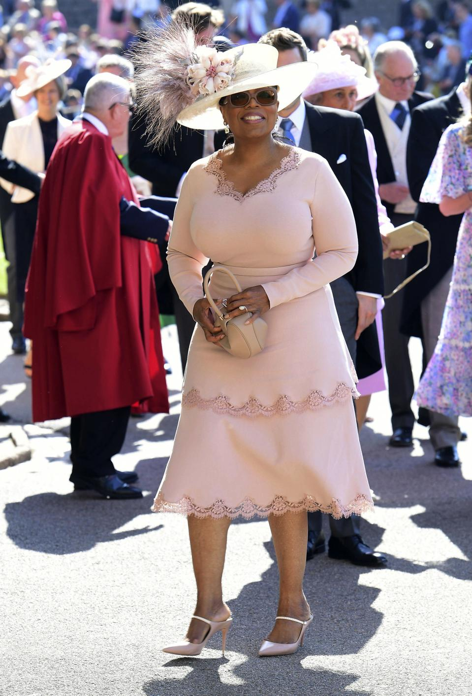 Oprah Winfrey is all smiles as she arrives at St George's Chapel at Windsor Castle.
