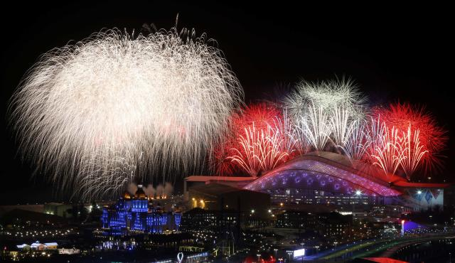 Fireworks are seen over the Olympic Park during the opening ceremony of the Sochi 2014 Winter Olympics, February 7, 2014. Sochi will host the 2014 Winter Olympic Games from February 7 to February 23. REUTERS/Alexander Demianchuk (RUSSIA - Tags: SPORT OLYMPICS)