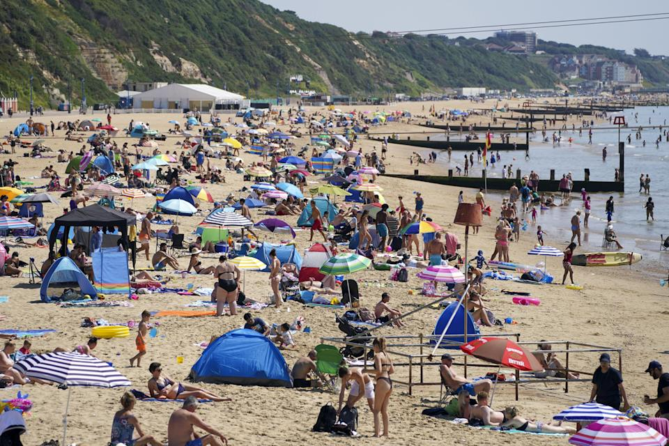 People enjoy the weather on Bournemouth beach in Dorset (Steve Parsons/PA) (PA Wire)