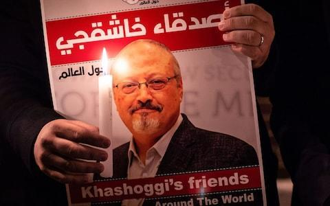 A demonstrator holds a poster of Saudi journalist Jamal Khashoggi during a gathering outside the Saudi Arabia consulate in Istanbul - Credit: YASIN AKGUL/ AFP