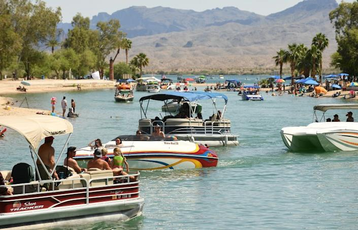 """Boats pass through a channel in Lake Havasu City, Ariz., on May 9. The city has been crowded by an influx of Californians over the last few weekends. <span class=""""copyright"""">(Wally Skalij / Los Angeles Times)</span>"""