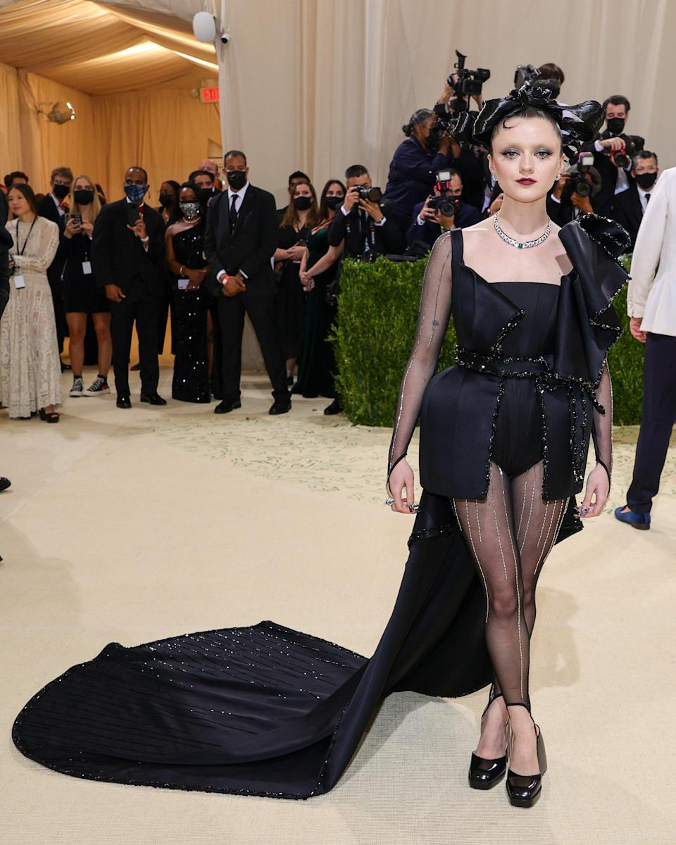 """<h2>Maisie Williams wearing Reuben Selby <br></h2><br>Maisie Williams is giving Helena Bonham Carter-meets-<em>The Matrix</em> vibes in this black high-low gown designed by her boyfriend Reuben Selby. <span class=""""copyright"""">Photo by Theo Wargo/Getty Images</span>"""