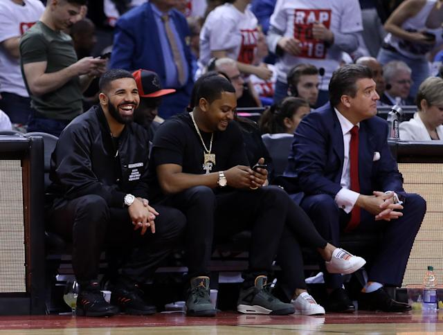 Drake, left, was at his customary courtside seat for Game 1 Tuesday night. (Getty)