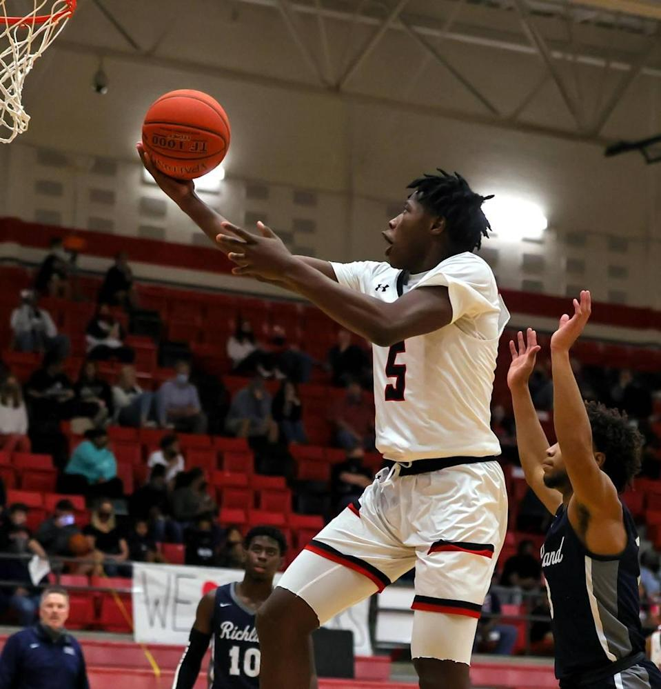 Mansfield Legacy Quion Williams (5) drives past Richland guard CJ Nelson (R) for two points during the first half of a 5A Region 1 Boys Basketball Area-Round 2 playoff game played on February 24, 2021 at Burleson High School. (Steve Nurenberg Special to the Star-Telegram)