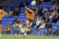 Australia's Quade Cooper kicks a penalty against South Africa during their Rugby Championship match on Sunday, Sept. 12, 2021, Gold Coast, Australia. (AP Photo/Tertius Pickard)