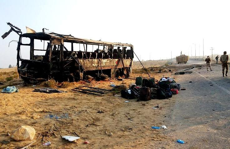 In this imaged released on the official Facebook page of the Egyptian Military Spokesman of the Armed Forces, Egyptian military soldiers inspect the scene near a destroyed bus, after a suicide attacker drove his explosive-laden car into the bus at the road between the border town of Rafah and the coastal city of el-Arish, Egypt, Wednesday, Nov. 20, 2013, killing nearly a dozen and wounding dozens more, security and military officials said. (AP Photo/The Official Facebook Page of the Egyptian Military Spokesman of the Armed Forces)