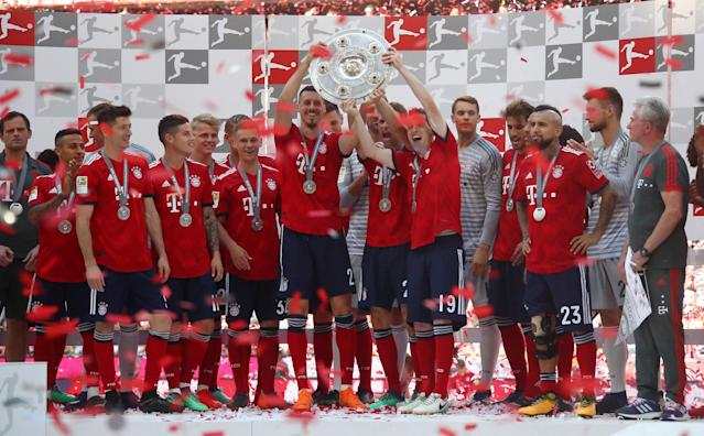 Soccer Football - Bundesliga - Bayern Munich v VfB Stuttgart - Allianz Arena, Munich, Germany - May 12, 2018 Bayern Munich celebrate winning the Bundesliga with the trophy REUTERS/Michael Dalder DFL RULES TO LIMIT THE ONLINE USAGE DURING MATCH TIME TO 15 PICTURES PER GAME. IMAGE SEQUENCES TO SIMULATE VIDEO IS NOT ALLOWED AT ANY TIME. FOR FURTHER QUERIES PLEASE CONTACT DFL DIRECTLY AT + 49 69 650050
