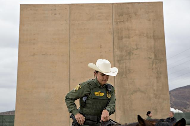 <p>A U.S. Border Patrol agent sits on a horse in front of a U.S.-Mexico border wall prototype while patrolling in San Diego, Calif., on Monday, Oct. 30, 2017. (Photo: Daniel Acker/Bloomberg via Getty Images </p>