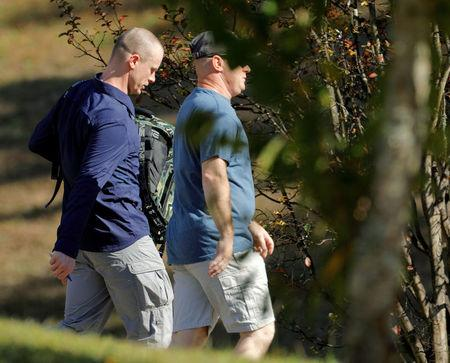 Bowe Bergdahl (L), who was demoted and dishonorably discharged from the U.S. Army for abandoning his post in Afghanistan, wears civilian clothes as he leaves the courthouse at the conclusion of his court martial at Fort Bragg, North Carolina, U.S., November 3, 2017.  REUTERS/Jonathan Drake