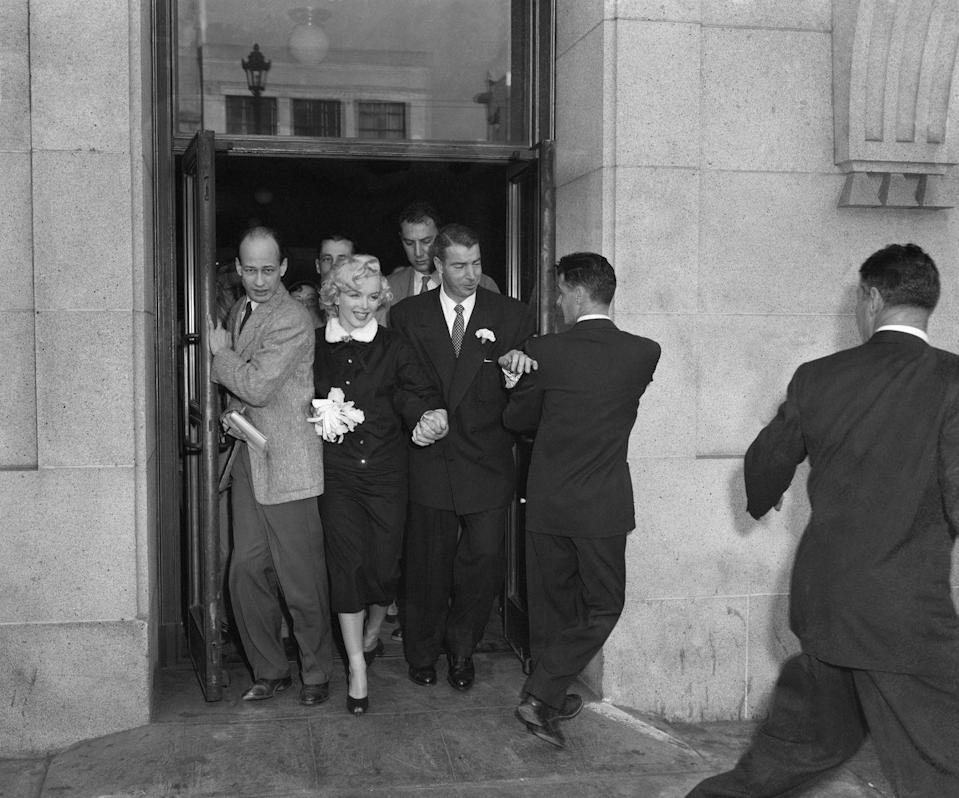<p>The press flooded San Francisco's courthouse when news traveled that film star Marilyn Monroe and famous baseball player Joe DiMaggio were eloping in a civil ceremony. Sadly, they were married for less than a year.</p>