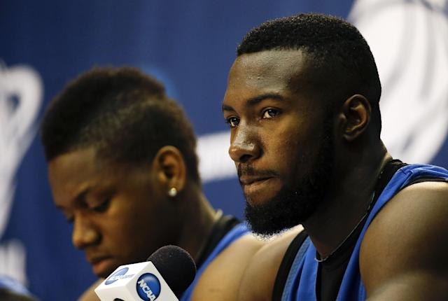 Florida center Patric Young listens to a question during a news conference Friday, March 28, 2014 in Memphis, Tenn. Florida will play Dayton Saturday in an NCAA college basketball tournament regional championship game. (AP Photo/Mark Humphrey)