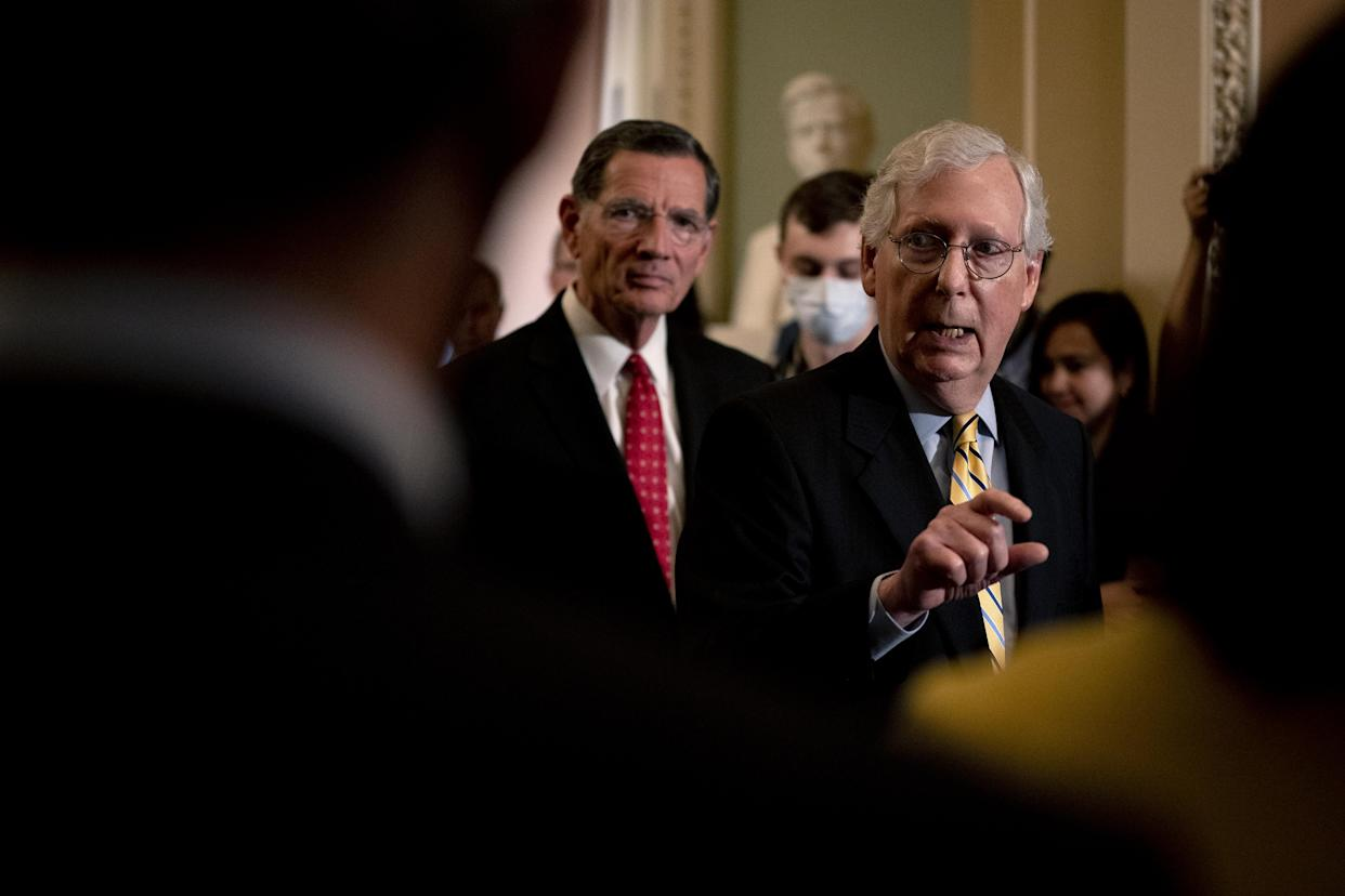 Senate Minority Leader Mitch McConnell, R-Ky., right, at a news conference in the U.S. Capitol on in June.