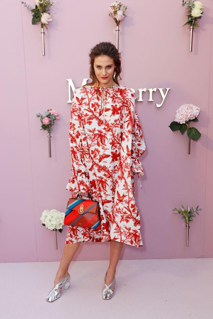 <p>We'll be digging out the florals soon thanks to model Charlotte Wiggins' look at the Mulberry show. <em>[Photo: Getty]</em> </p>