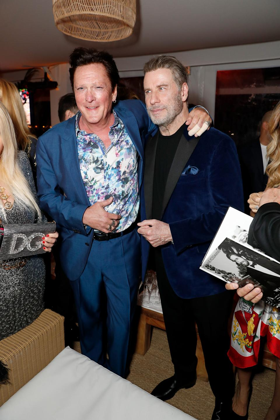 CANNES, FRANCE - MAY 13: Michael Madsen (L) and John Travolta attend the HFPA Event with Particpant Media to Honor the Kailash Satyarthi Children's Foundation in partnership with Renault at Nikki Beach on May 13, 2018 in Cannes, France.  (Photo by David M. Benett/Dave Benett/Getty Images for Nikki Beach)