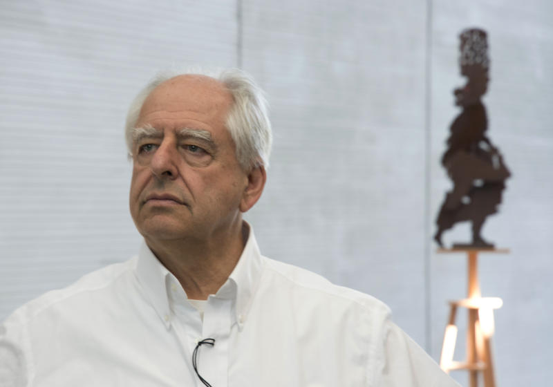South African artist William Kentridge at the opening of his exhibition in Cape Town, South Africa, Friday, Aug. 23, 2019. Kentridge's work of evocative videos, graphic tapestries, charcoal drawings, woodcut prints, sculptures and immersive sound installations combine in his largest single show in which he explores compelling themes including the country's apartheid history and the participation of Africans in World War. (AP Photo/Trevor Samson)