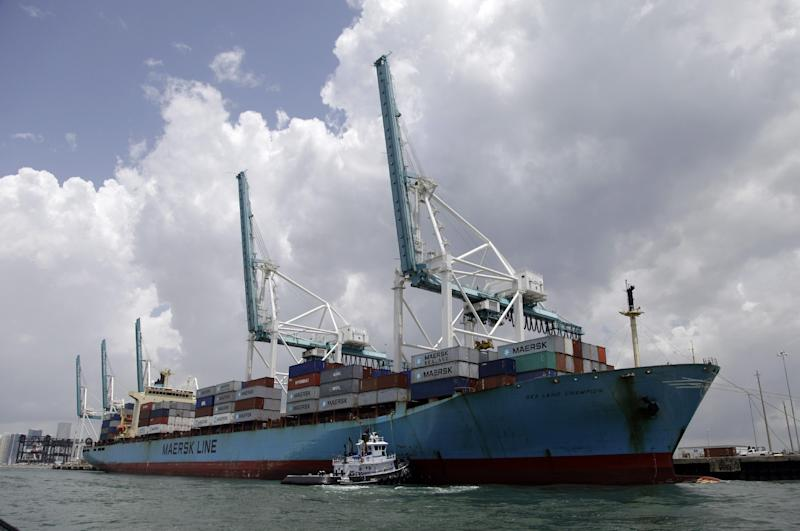 FILE- In this Friday, May 18, 2012, file photo, a Maersk freighter is loaded with shipping containers at the Port of Miami in Miami.  The U.S. trade deficit narrowed in May from April, helped by cheaper oil that lowered imports and an increase in American exports to Europe and China. But economists cautioned that the global economy has weakened since then. And they noted that the decline in the deficit. (AP Photo/Lynne Sladky, File)