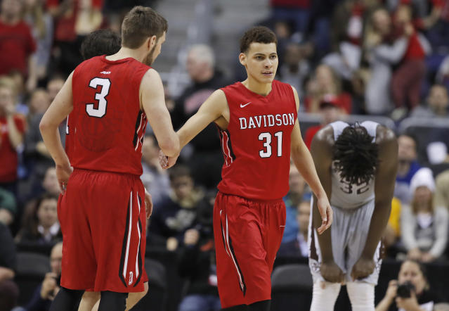 Davidson guards Jordan Watkins (2) and Kellan Grady (31) celebrate after a play as St. Bonaventure center Amadi Ikpeze reacts at right, during the second half of an NCAA college basketball game in the semifinals of the Atlantic 10 Conference tournament, Saturday, March 10, 2018, in Washington. Davidson won 82-70. (AP Photo/Alex Brandon)