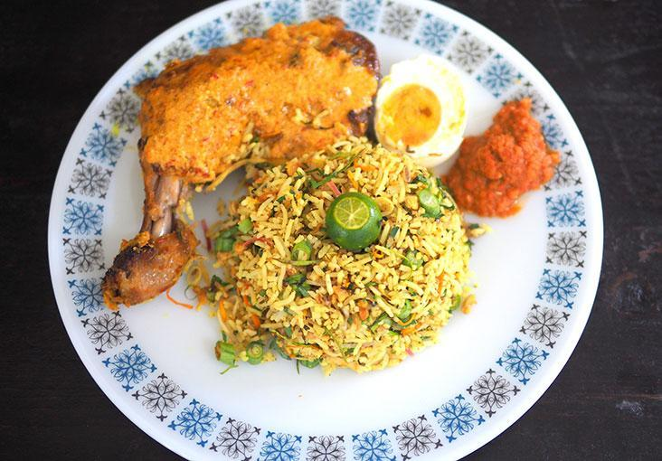Lunch just got better with The Secret Foodsmith's nasi ulam with finely cut herbs served with juicy 'ayam percik' and salted egg – Pictures by Lee Khang Yi