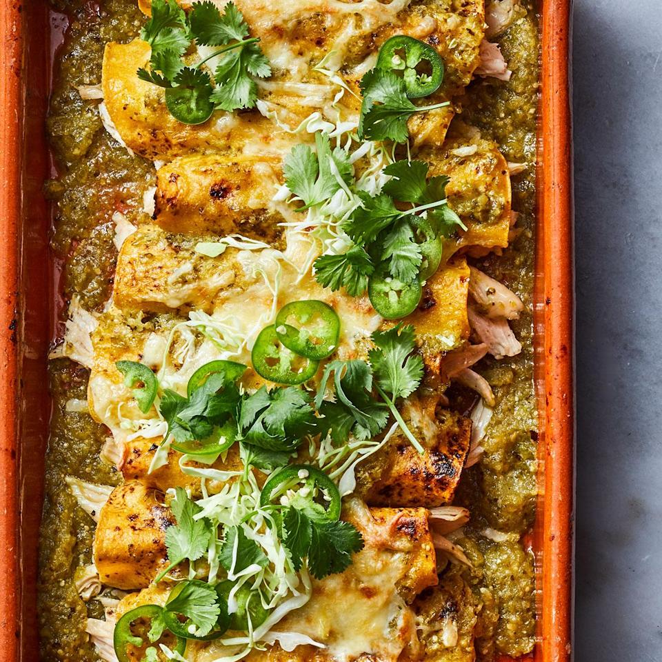<p>Roasting tomatillos before pureeing them into a green enchilada sauce adds another dimension of flavor and a little sweetness. Put out plenty of toppings so everyone can add what they like.</p>