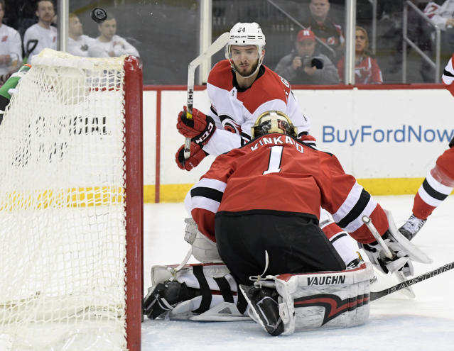 New Jersey Devils goaltender Keith Kinkaid (1) deflects a shot by Carolina Hurricanes left wing Phillip Di Giuseppe (34) during the first period of an NHL hockey game Tuesday, March 27, 2018, in Newark, N.J. (AP Photo/Bill Kostroun)