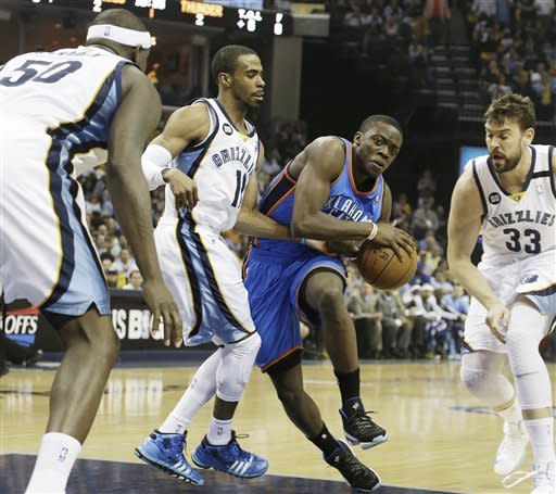 Memphis Grizzlies' Marc Gasol (33), of Spain, Mike Conley (11) and Zach Randolph (50) defend against Oklahoma City Thunder's Reggie Jackson during the first half of Game 3 in a Western Conference semifinal NBA basketball playoff series in Memphis, Tenn., Saturday, May 11, 2013. (AP Photo/Danny Johnston)