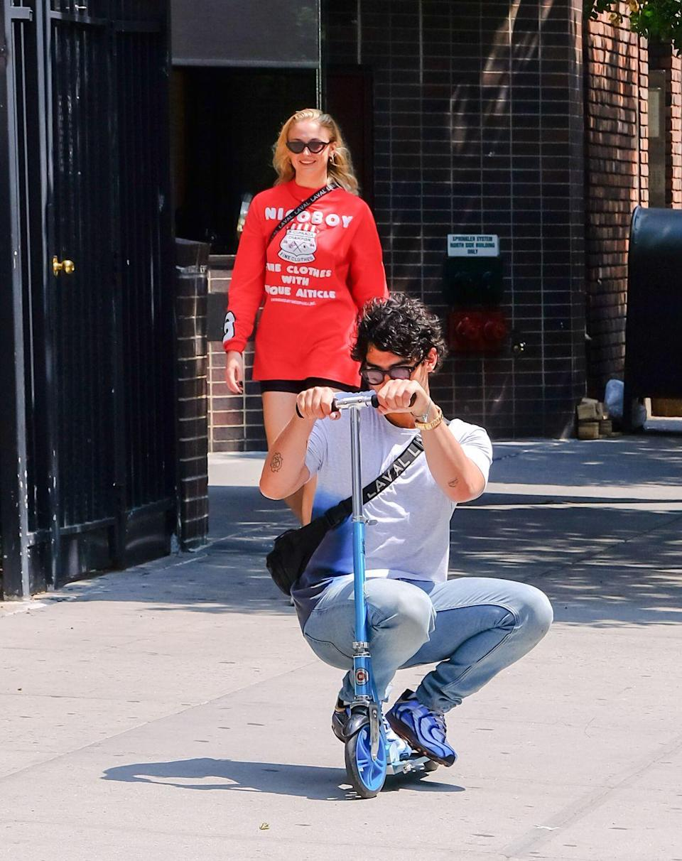 <p>When do these two not look like they're having fun?</p><p>Jonas tries out his scooter as Turner walks and laughs behind during a walk in NYC's Soho.</p>