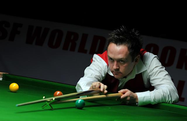 Lee Walker of Wales plays a shot during the IBSF World Snooker Championship against Hossein Vafaei Ayouri of Iran in Bangalore on December 3, 2011. Hossein beat Lee Walker of Wales by 10 frames to nine. AFP PHOTO/Manjunath KIRAN (Photo credit should read Manjunath Kiran/AFP/Getty Images)