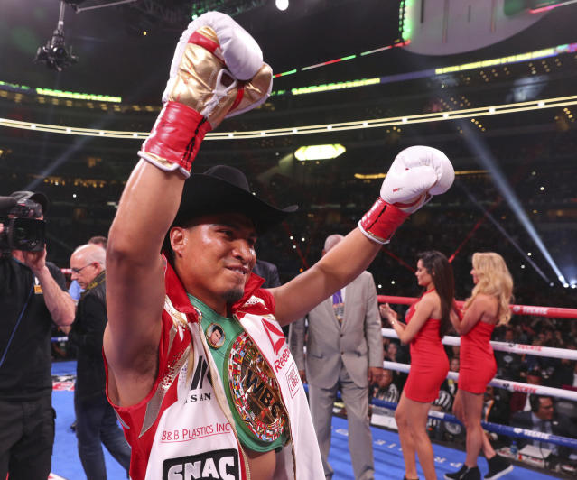 Mikey Garcia gestures for the crowd before an IBF World Welterweight Championship boxing bout against Errol Spence Jr. Saturday, March 16, 2019, in Arlington, Texas. (AP Photo/Richard W. Rodriguez)