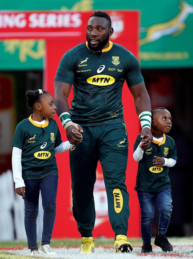 Rugby Union - Second Test International - South Africa v England - Free State Stadium, Bloemfontein, South Africa - June 16, 2018. South Africa's Tendai Mtawarira arrives with his children Talumba and Wangu Mtawarira as he celebrates his hundred cap for South Africa. REUTERS/Siphiwe Sibeko
