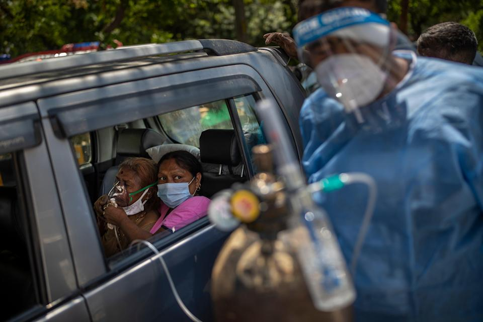 <p>A patient receives oxygen inside a car provided by a Gurdwara in New Delhi</p> (AP)