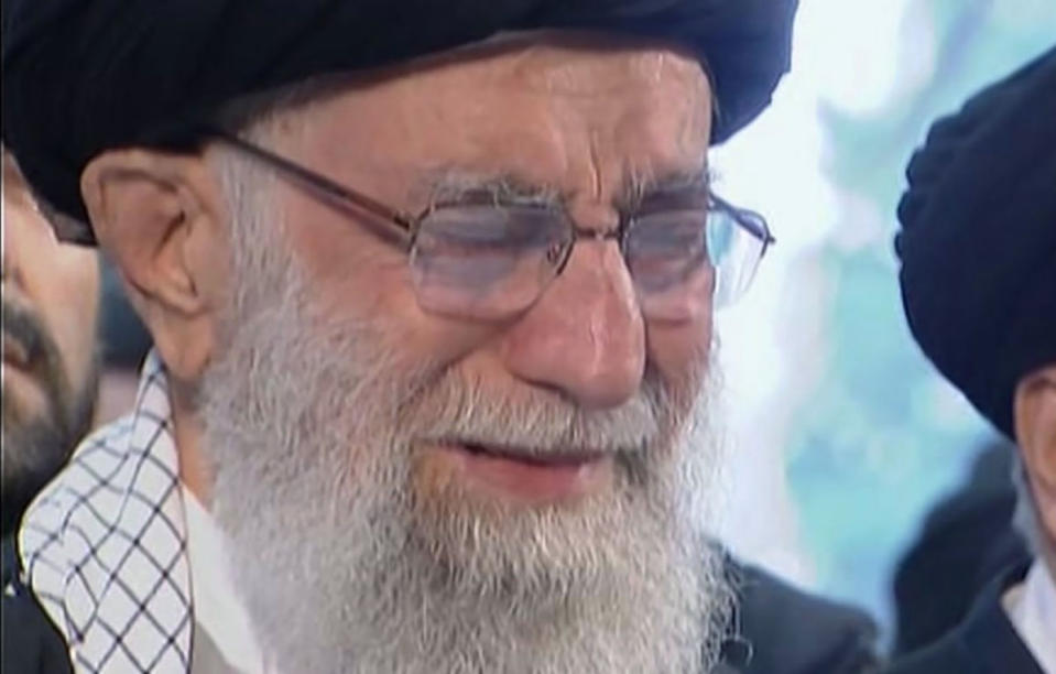 In this image taken from video, Iranian Supreme Leader Ayatollah Ali Khamenei openly weeps as he leads a prayer over the coffin of Gen. Qassem Soleimani, who was killed in Iraq in a U.S. drone strike on Friday, at the Tehran University campus, in Tehran, Iran, Monday, Jan. 6, 2020. (Iran Press TV via AP)