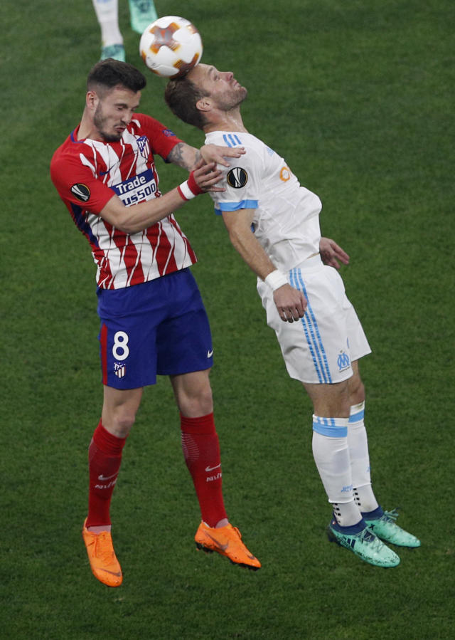 Atletico's Saul Niguez, left, fights to head the ball with Marseille's Valere Germain during the Europa League Final soccer match between Marseille and Atletico Madrid at the Stade de Lyon outside Lyon, France, Wednesday, May 16, 2018. (AP Photo/Christophe Ena)